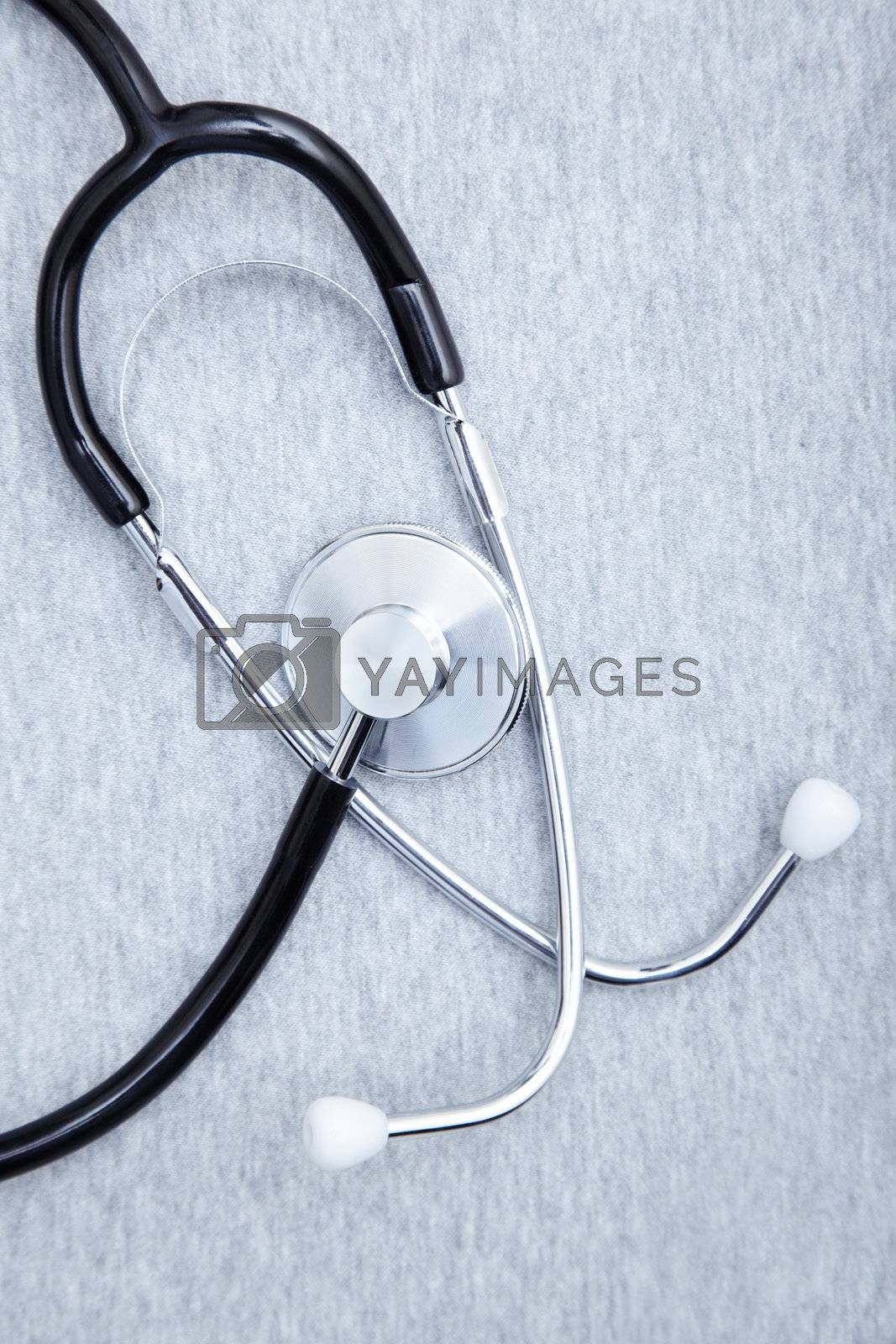 Medical stethoscope on a textured background. Close-up photo