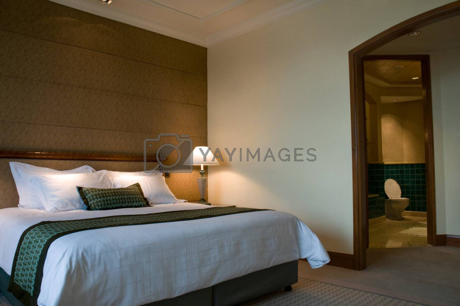 King size bed and luxury bathroom of a five star hotel suite room