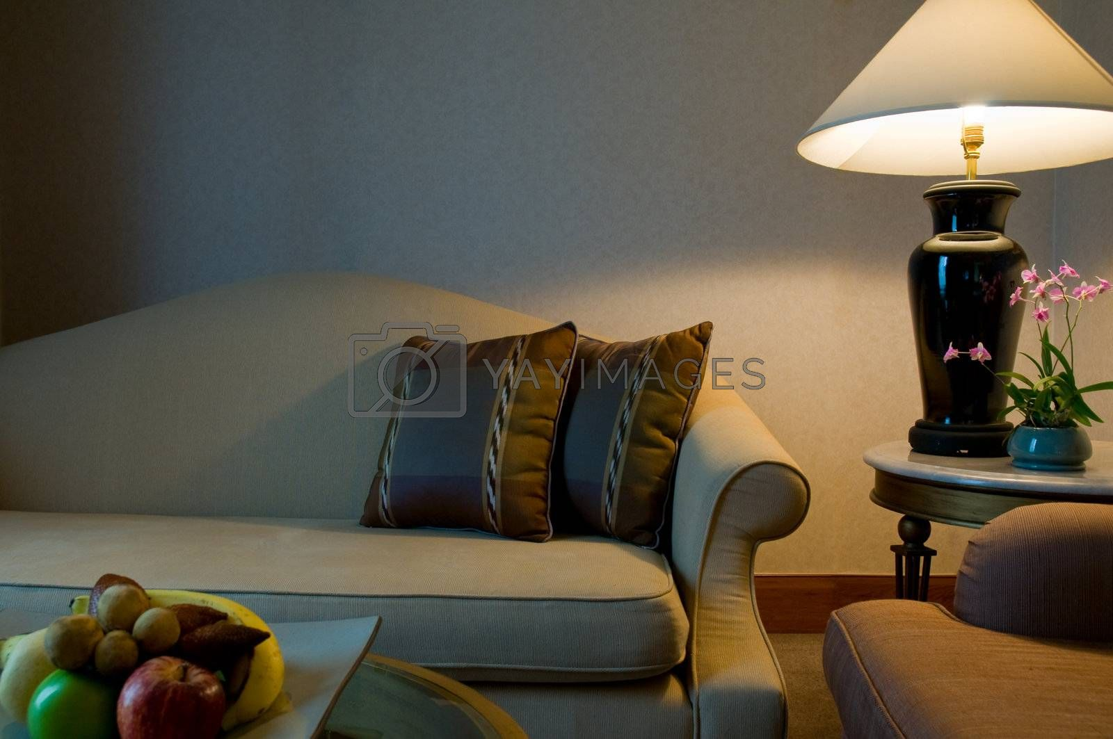 Sitting area of a 5 star luxury hotel suite room, with fruit and orchids