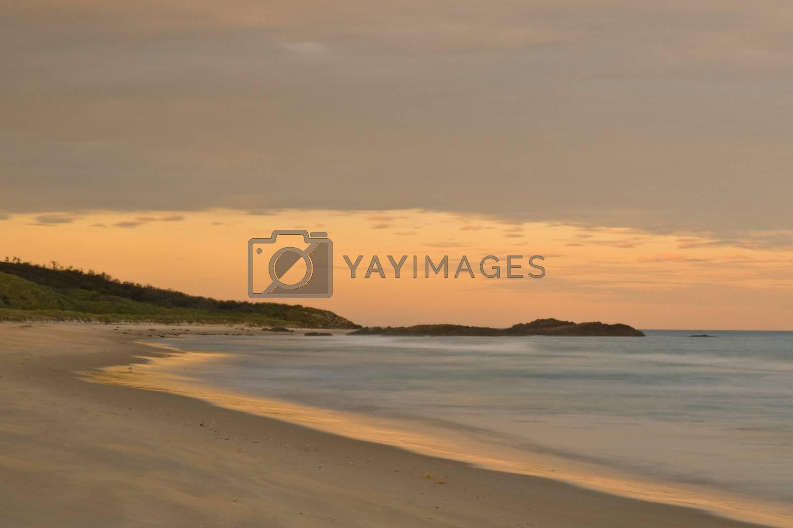 Golden light after a sunset at a beach, with long exposure