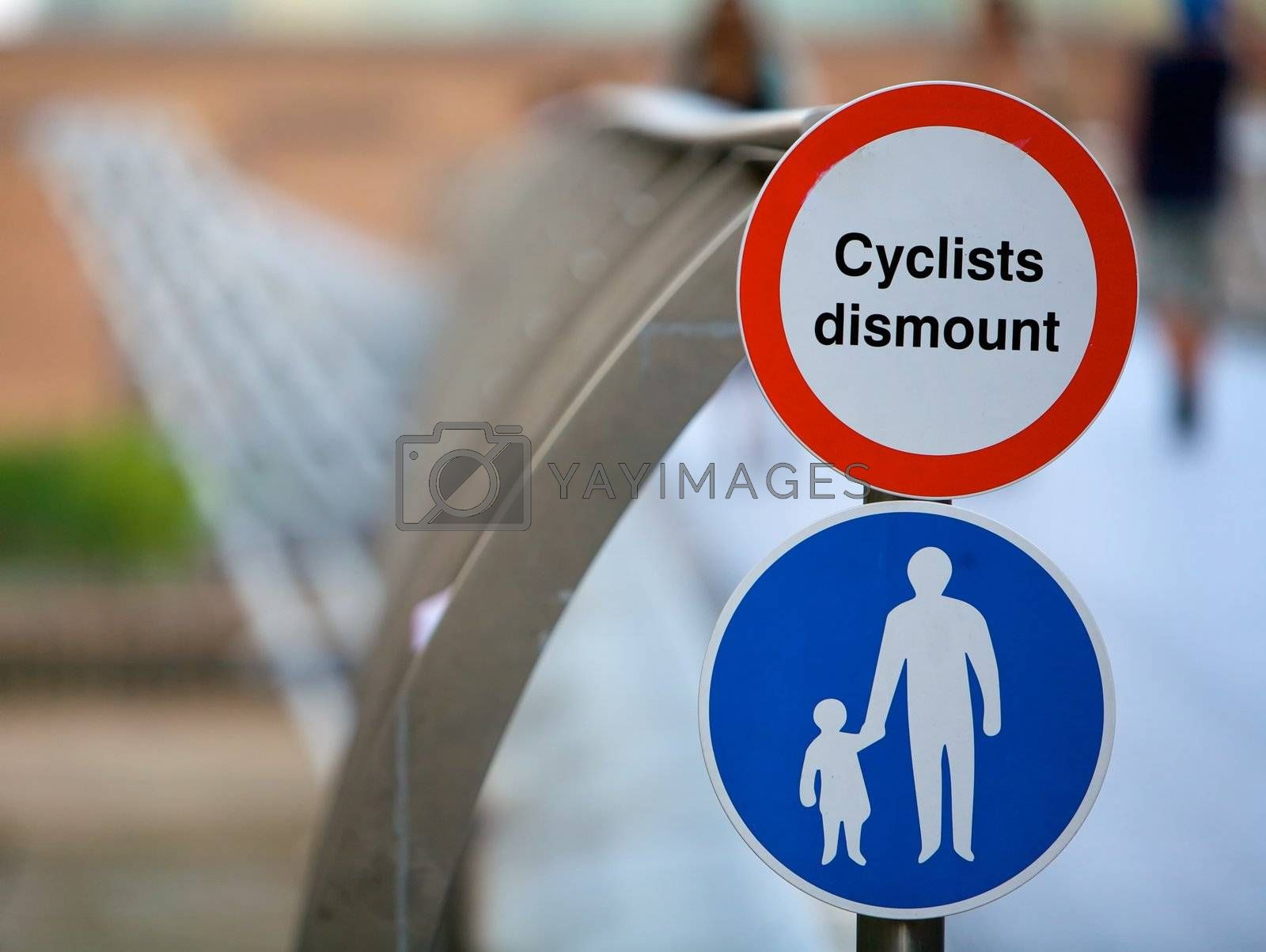 Cyclists track sign for bicycles on a bridge