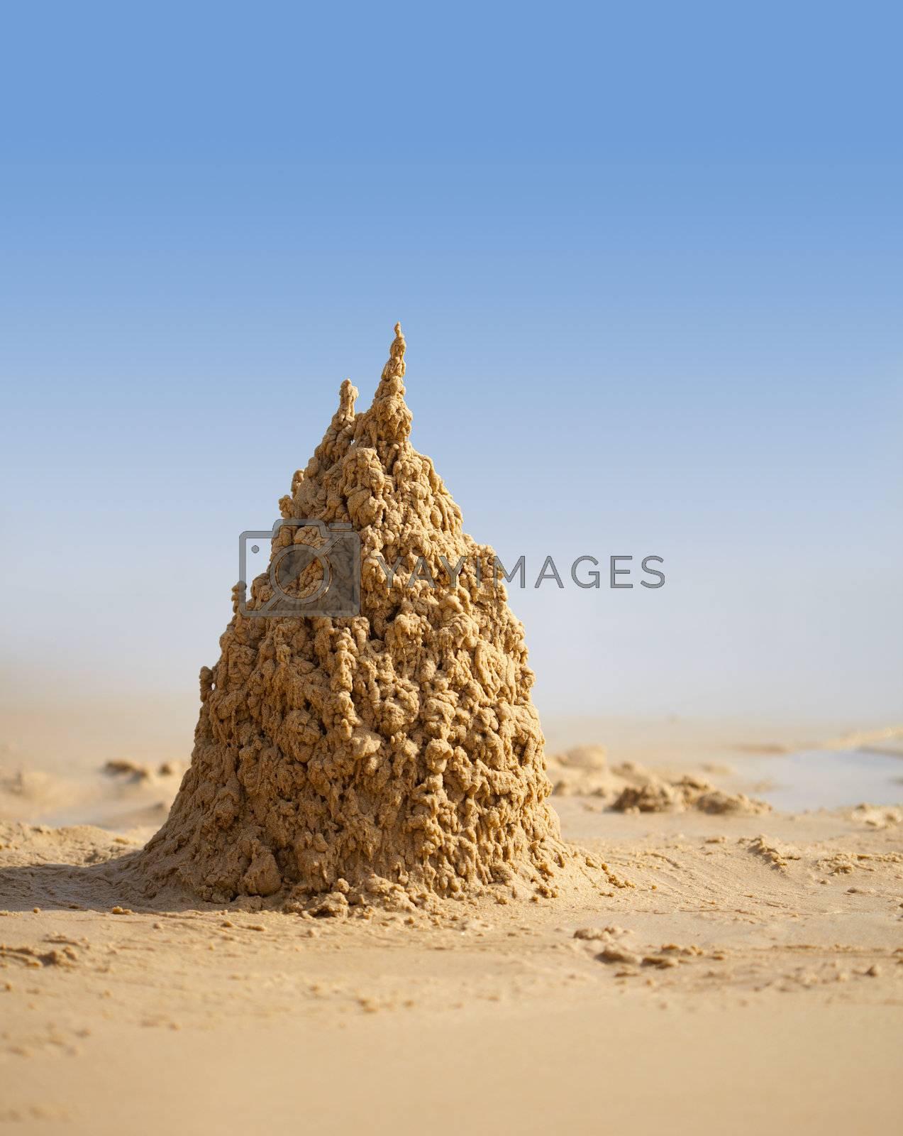 Surreal sand castle on a sunny tropical beach