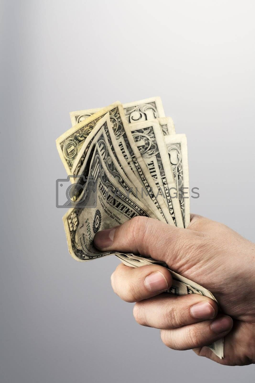 Man holding old US dollars in his hand.