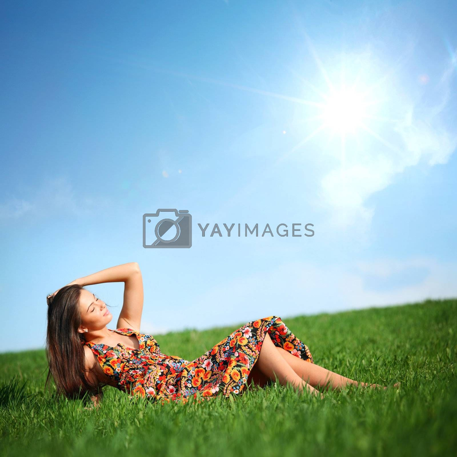 happy woman on green grass