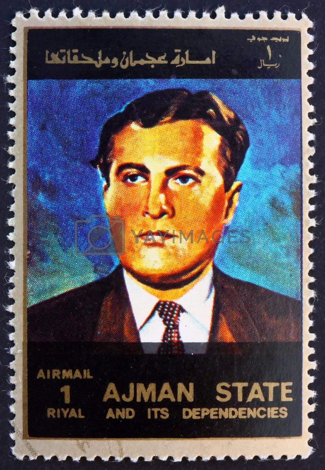 AJMAN - CIRCA 1973: a stamp printed in the Ajman shows Wernher von Braun, Rocket Scientist, Aerospace Engineer and Space Architect, circa 1973