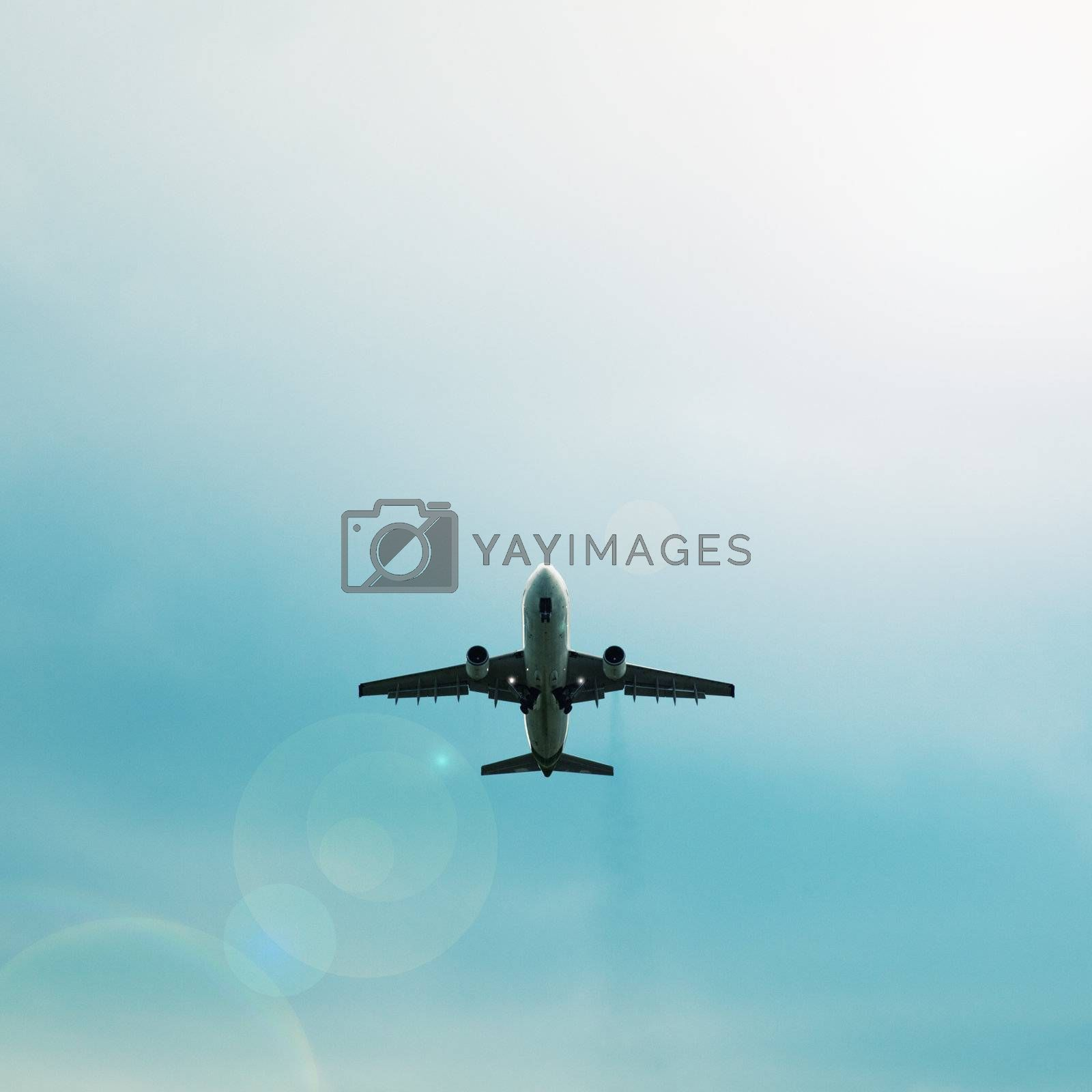 A passenger airplane flying in the blue sky - silhouette