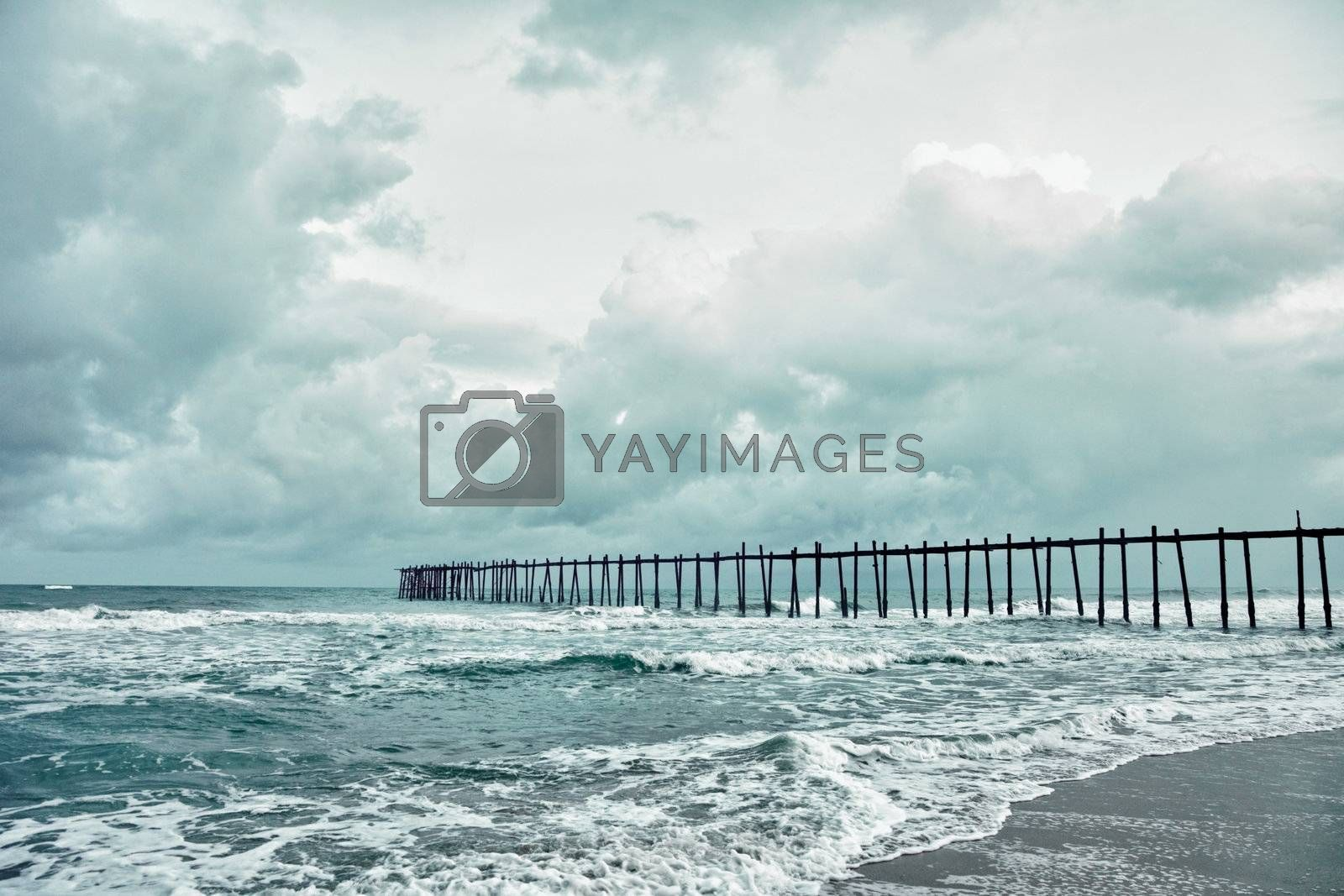 The wooden old jetty over the stormy sea