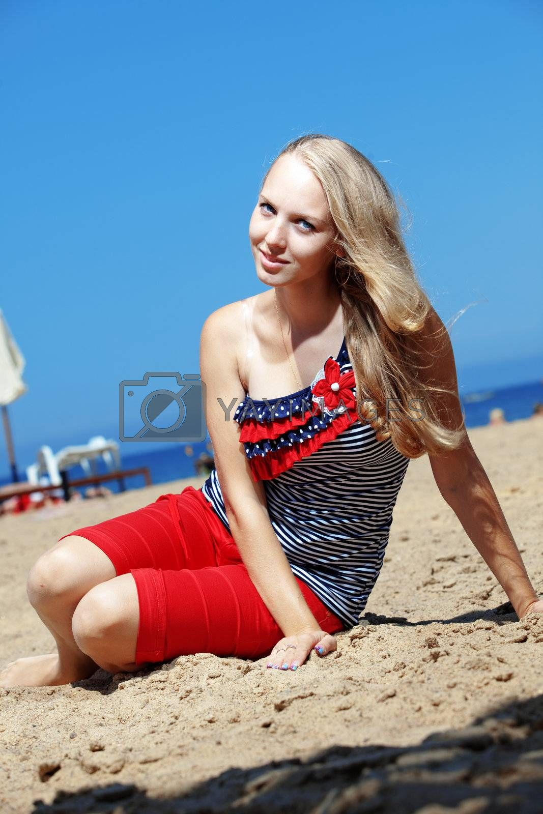 Young woman resting at the beach in summer