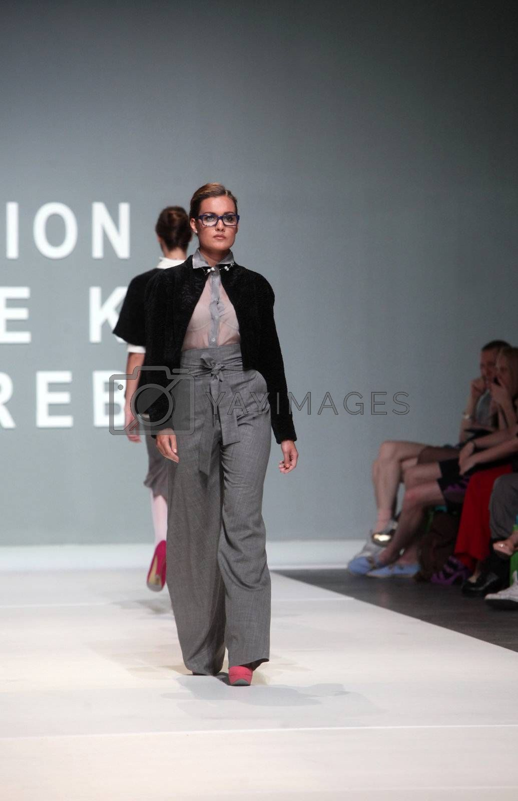 "ZAGREB, CROATIA - May 10: Fashion model wears clothes made by Aba Tomicic Drvar on ""ZAGREB FASHION WEEK"" show on May 10, 2012 in Zagreb, Croatia."