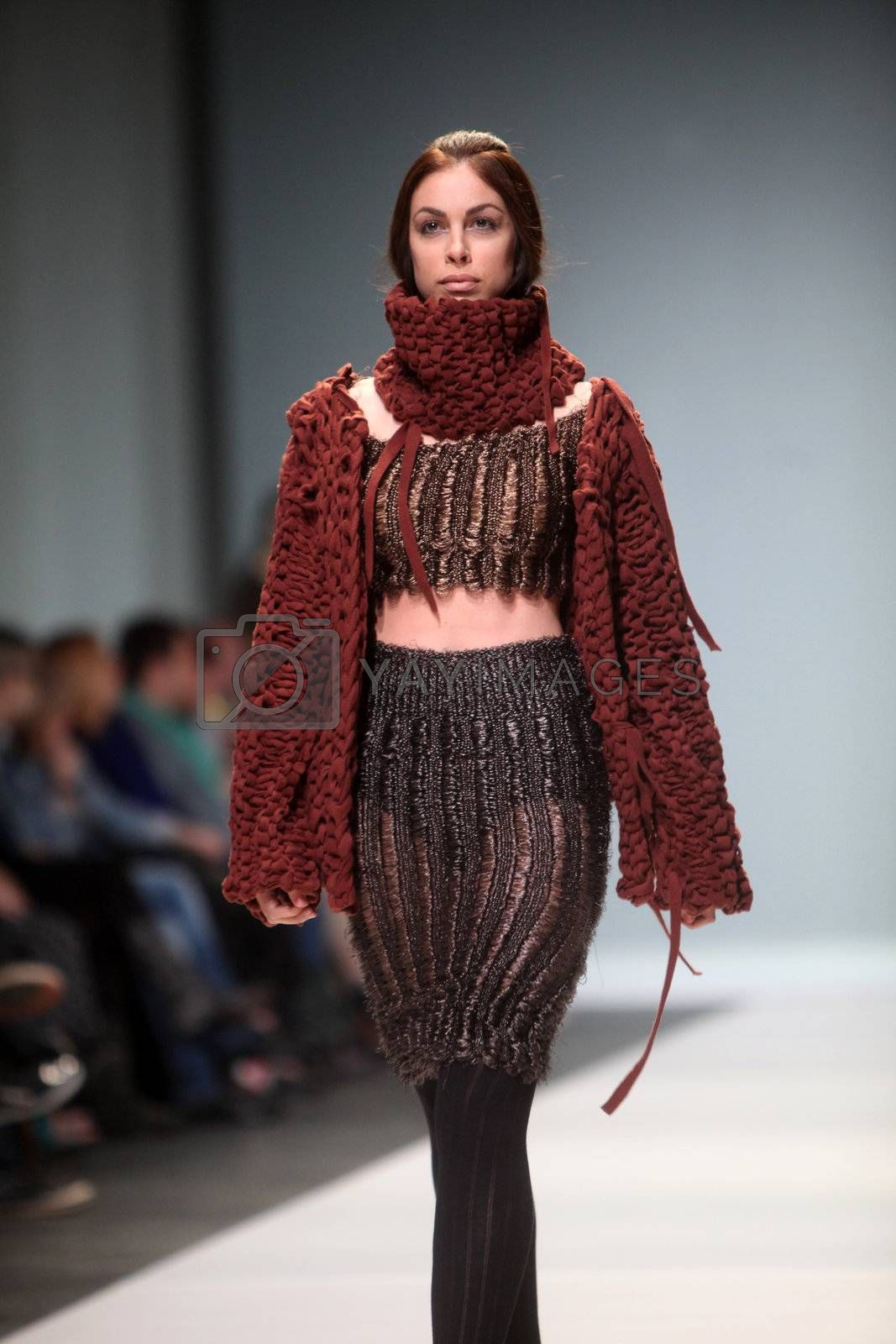 """ZAGREB, CROATIA - May 12: Fashion model wears clothes made by Craig Lawrence on """"ZAGREB FASHION WEEK"""" show on May 12, 2012 in Zagreb, Croatia."""