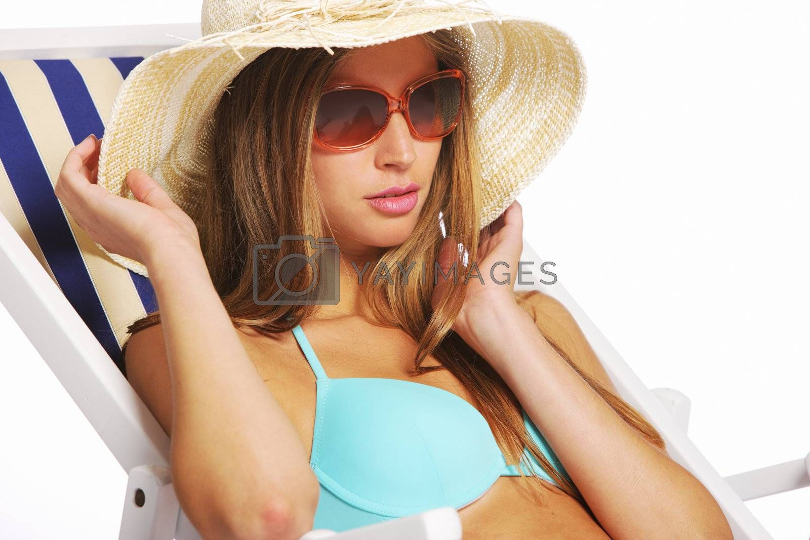 Beautiful young woman relaxing on beach chair, copy space