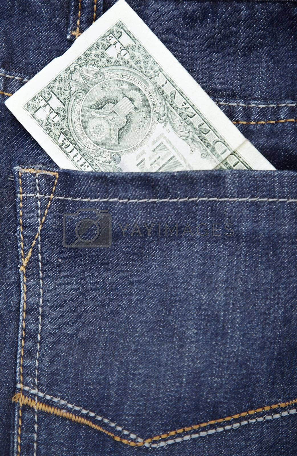 US dollar in the pocket of blue jeans. Close-up photo