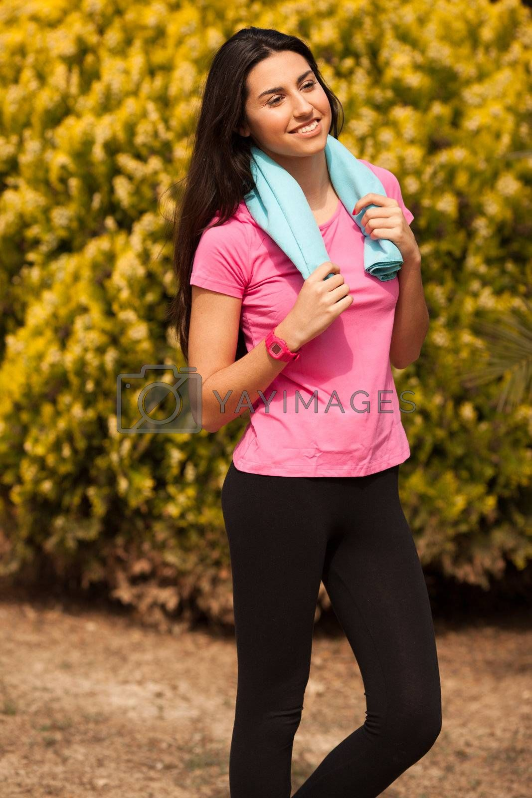 Sport woman with blue towell enjoying after fitness session
