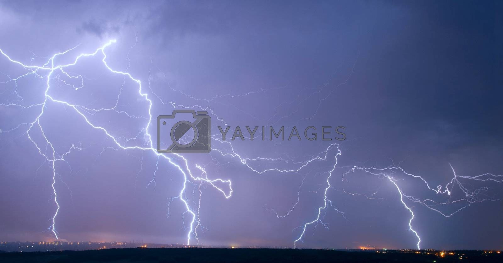 Many big lightning in the stormy sky over a city