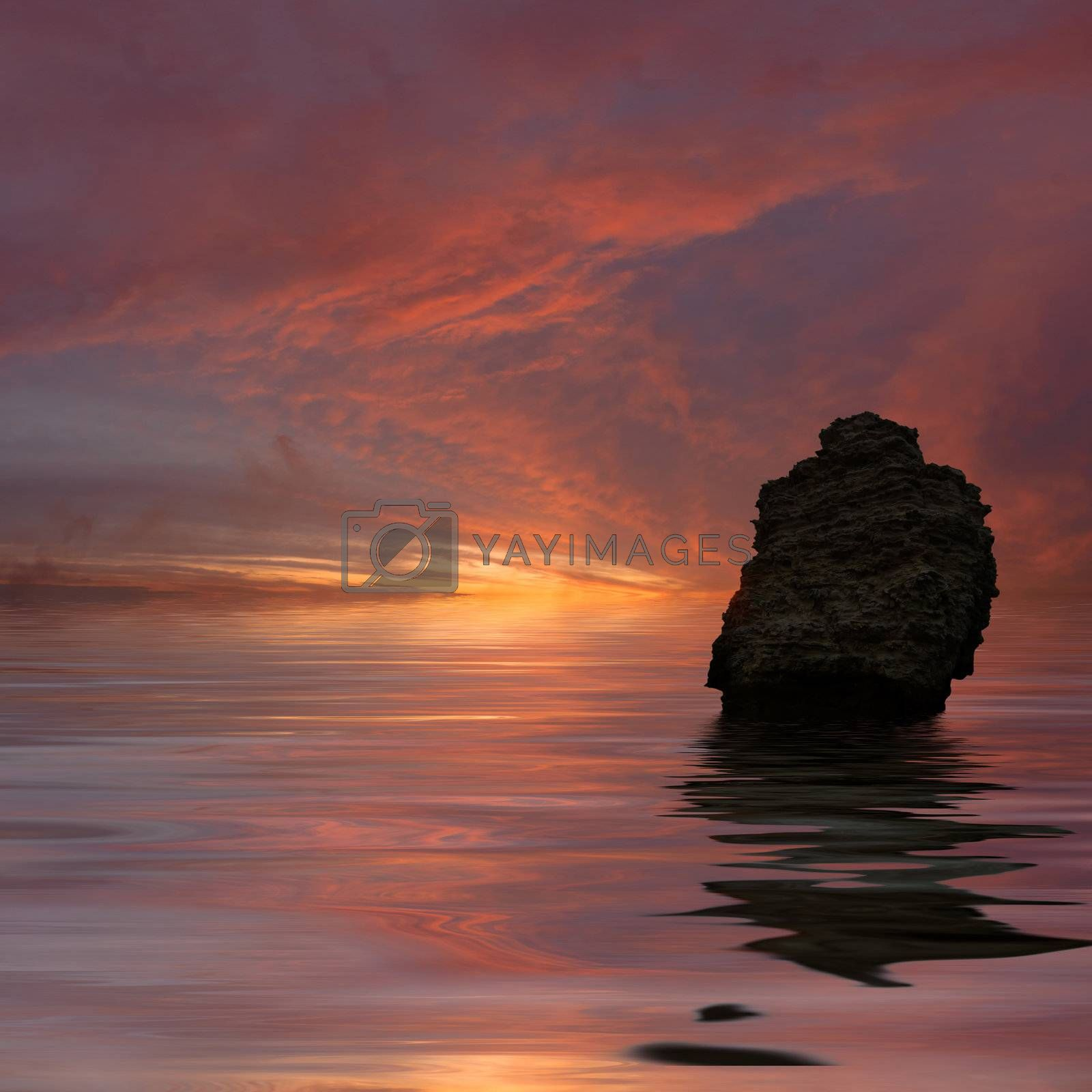Landscape with the lonely rock at the ocean and the colourful sunset which was reflected in water
