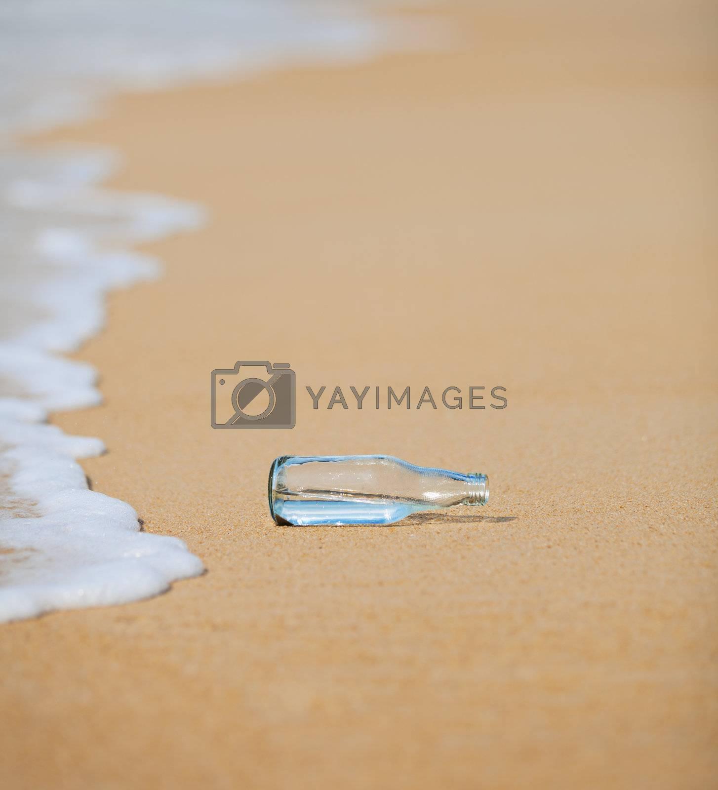 An empty bottle on the beach