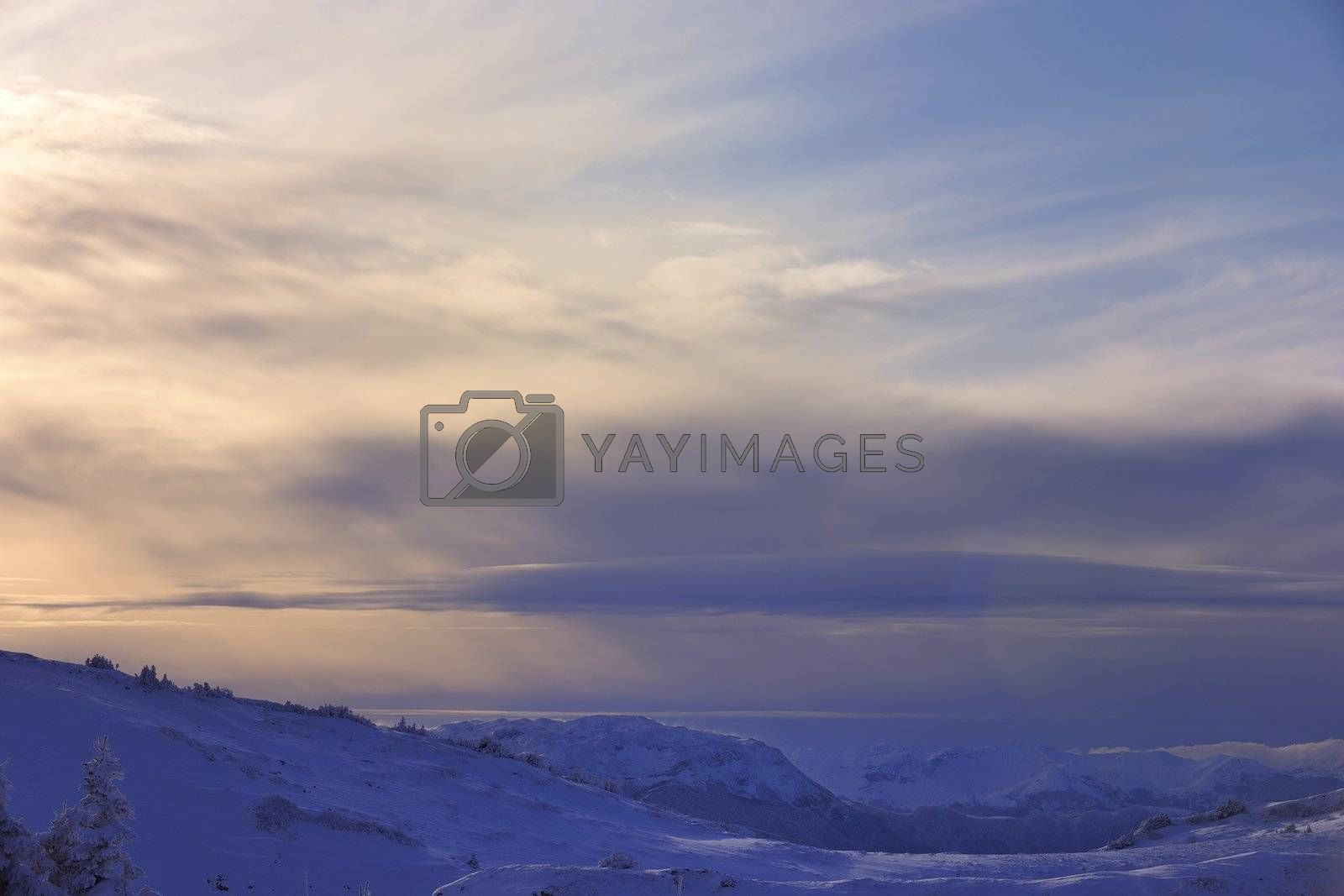 winter mountain landscape at sunny day and snow peaks