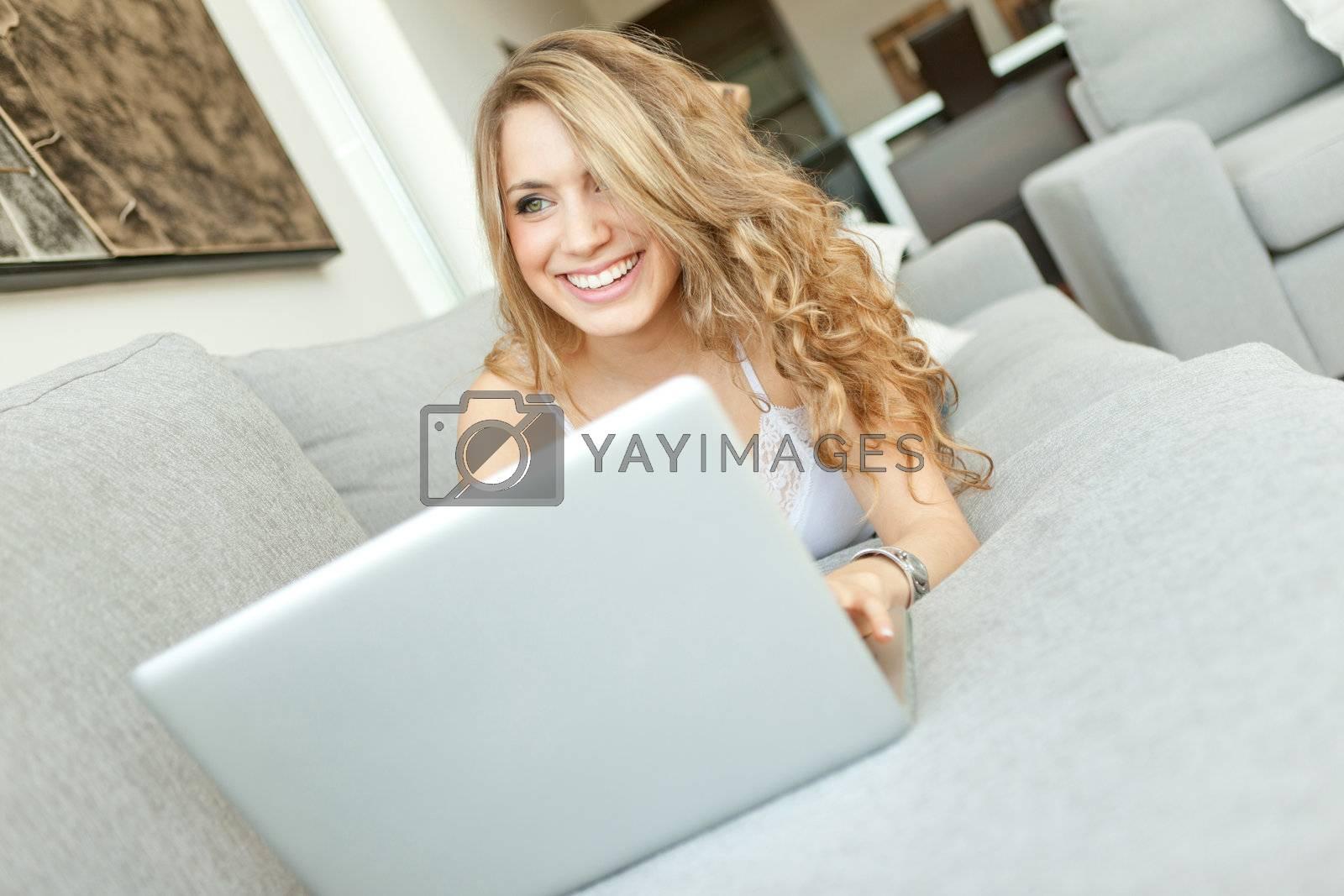 young beautiful woman using laptop computer