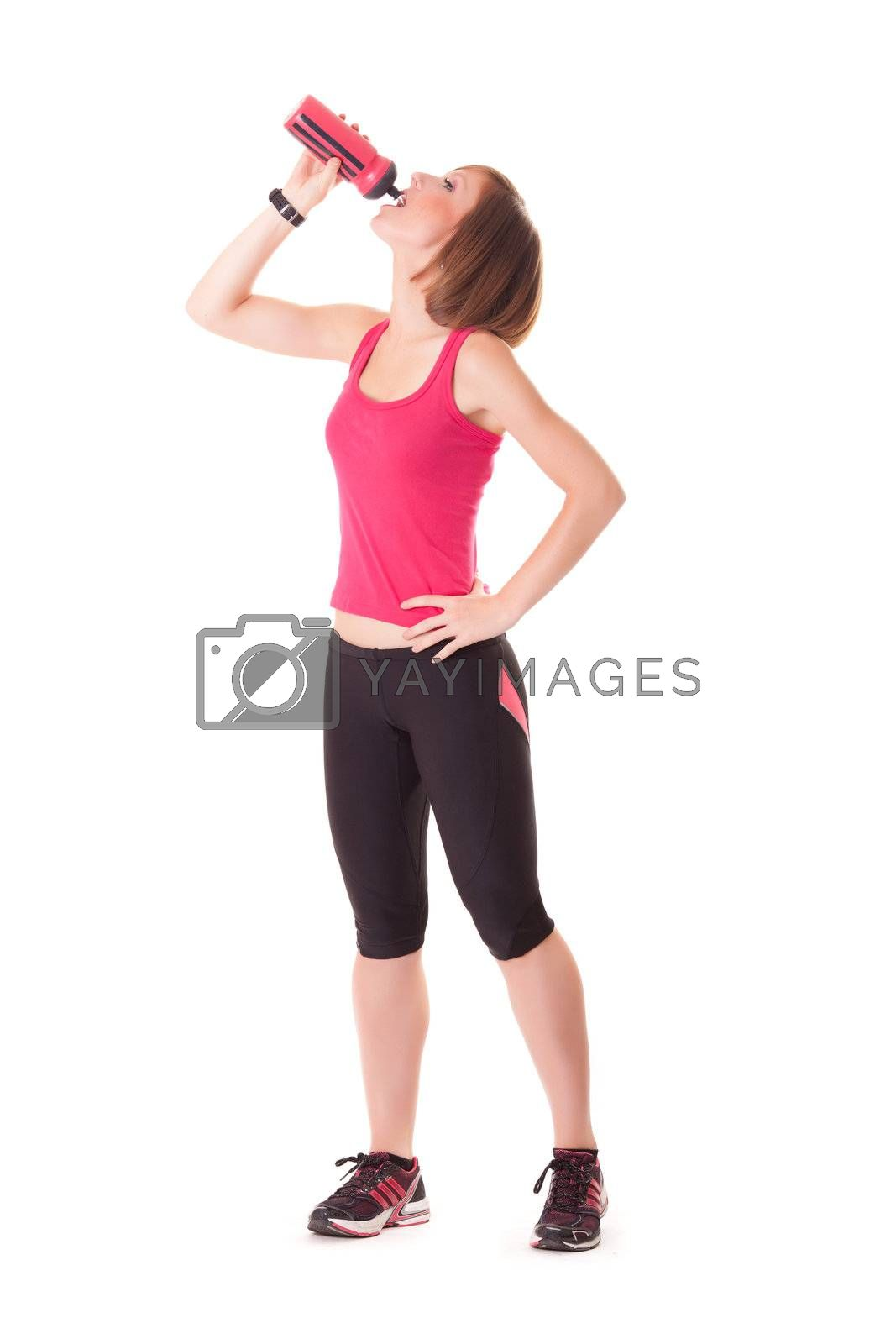 young beautiful sport woman drinking standing making elongation isolated on white background