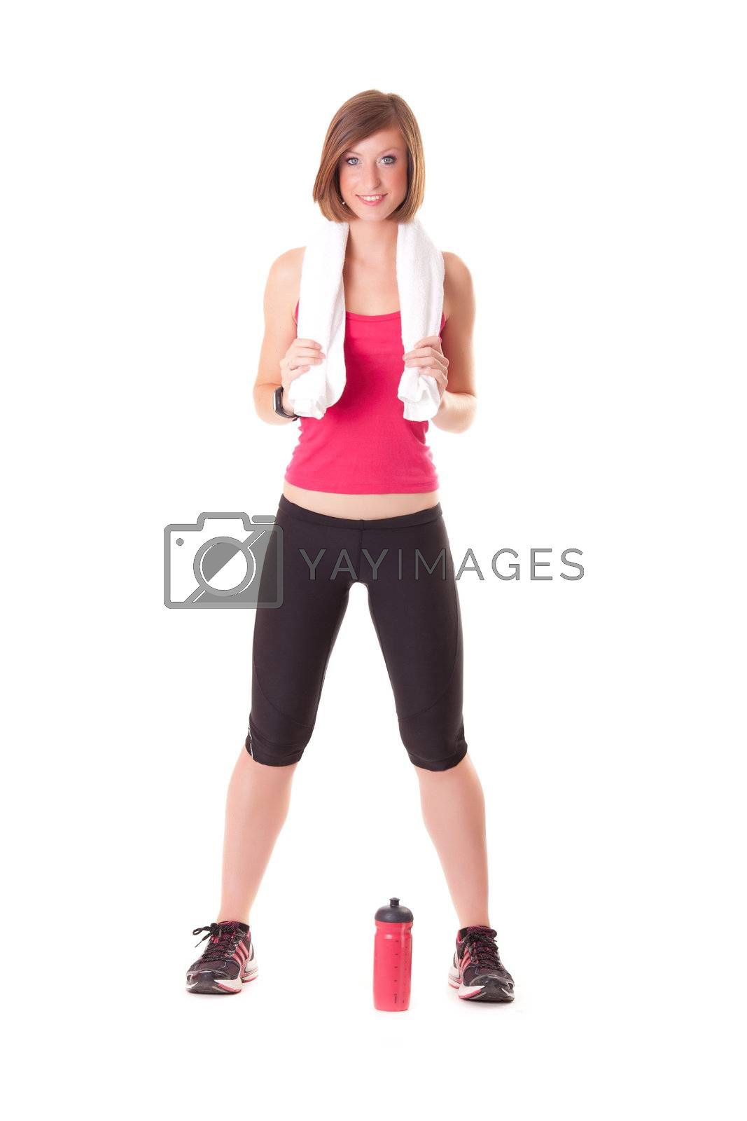 young beautiful sport woman standing with a towel isolated on white background
