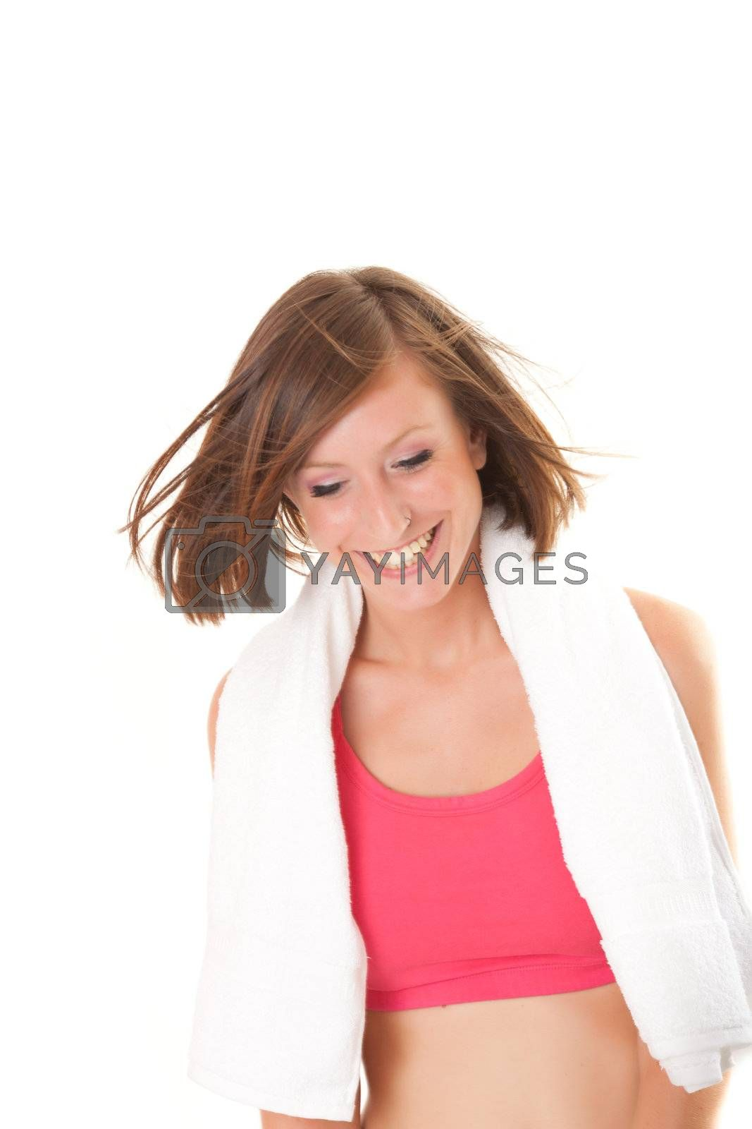young beautiful sport woman laughing with a towel and a bowl isolated on white background