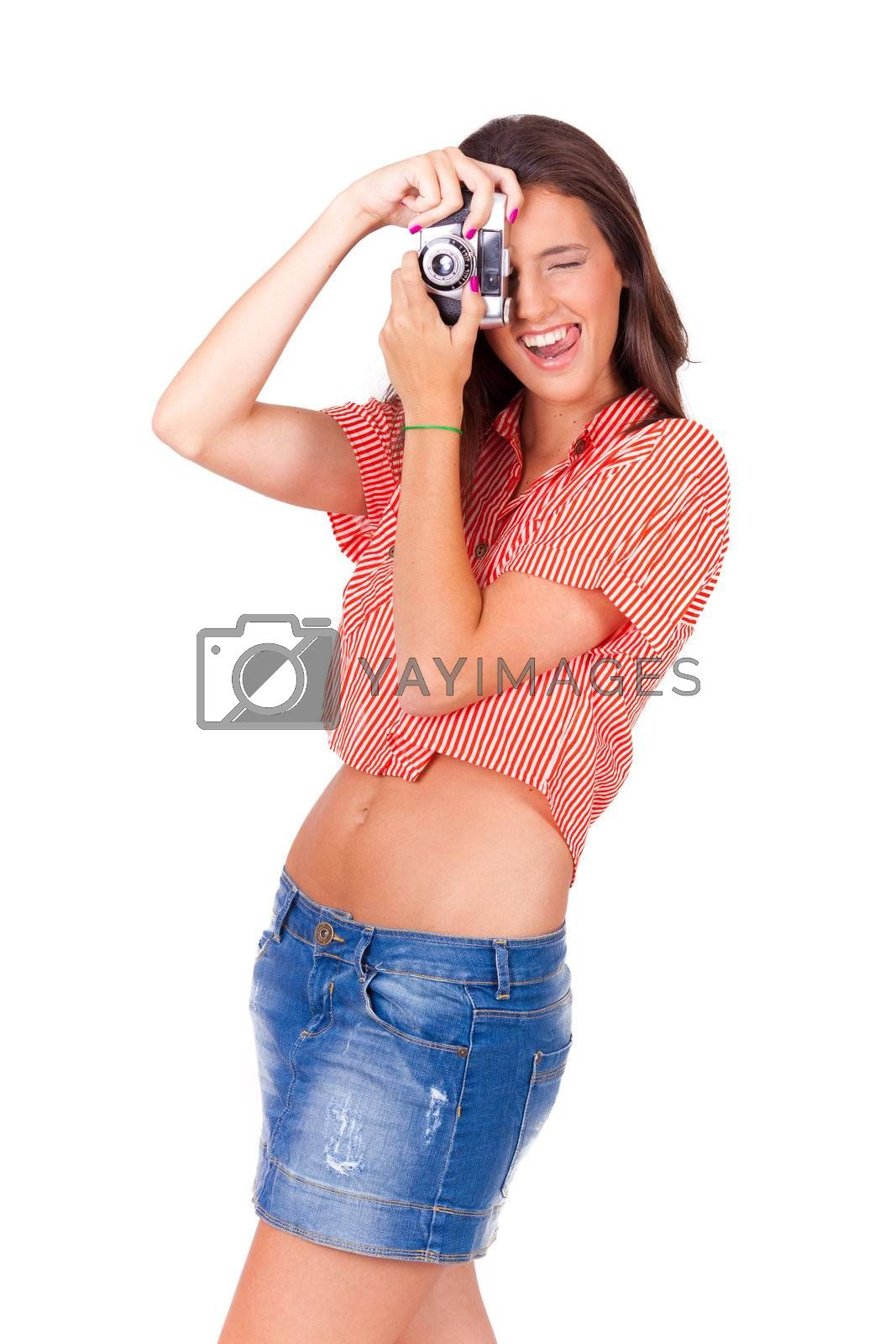 young women taking pictures with vintage camera on white background