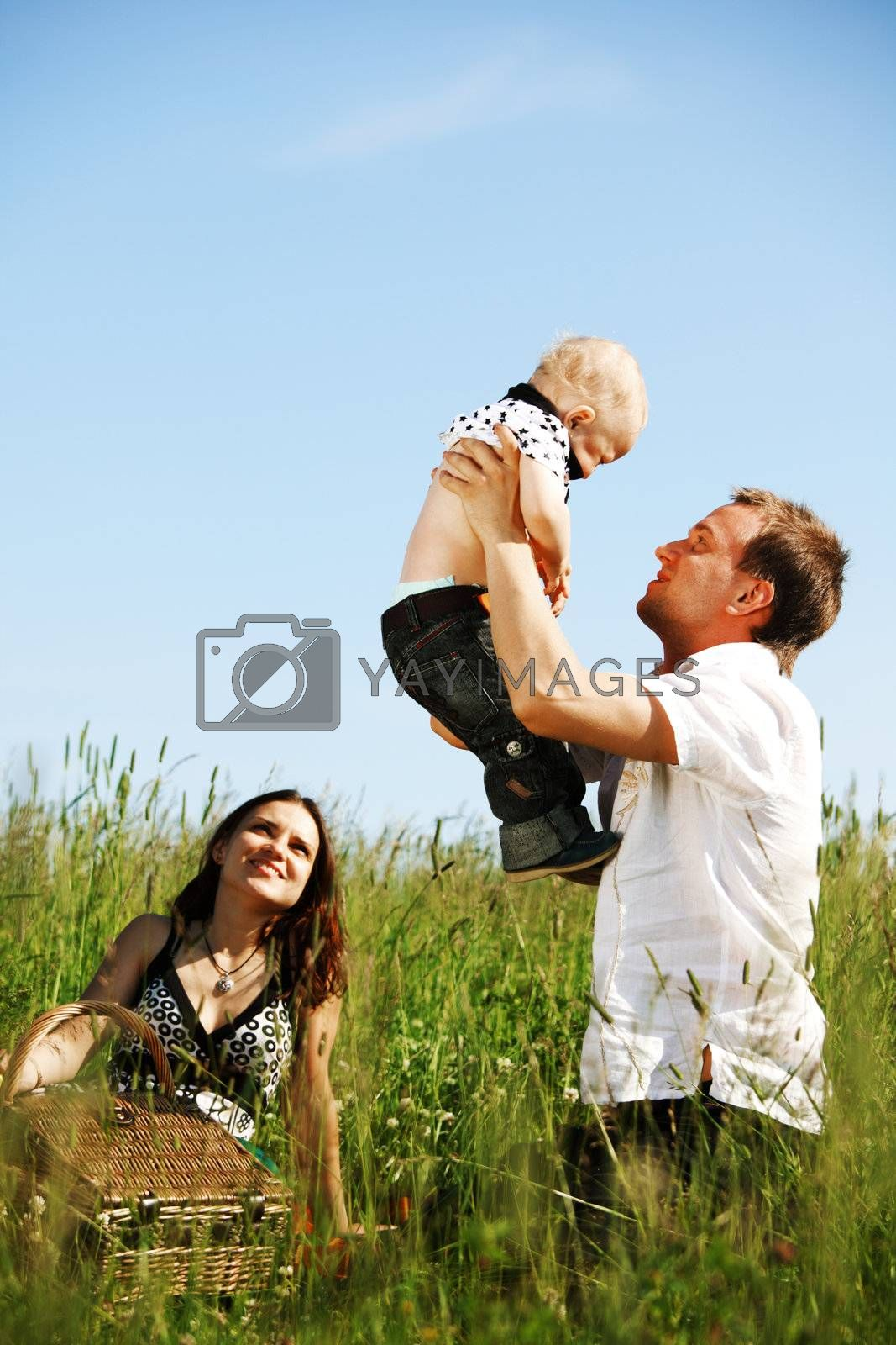 happy family in green grass