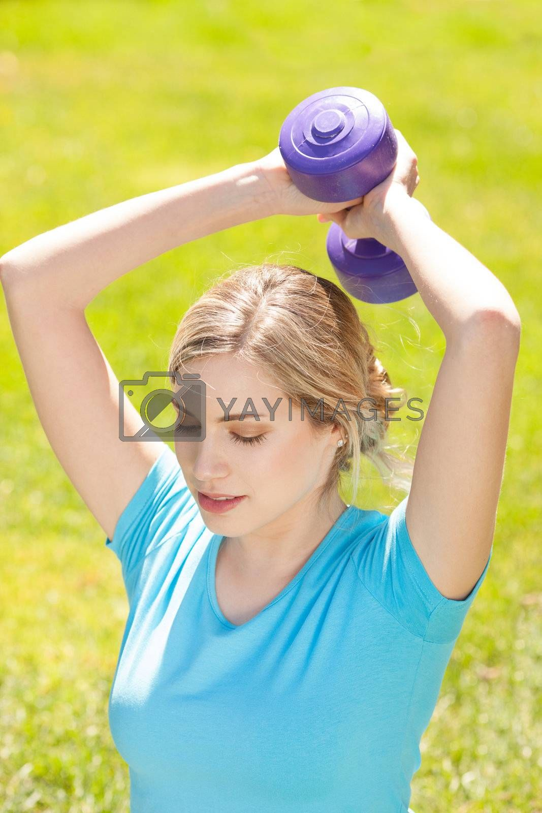 Young sport woman lift weight work out outdoors