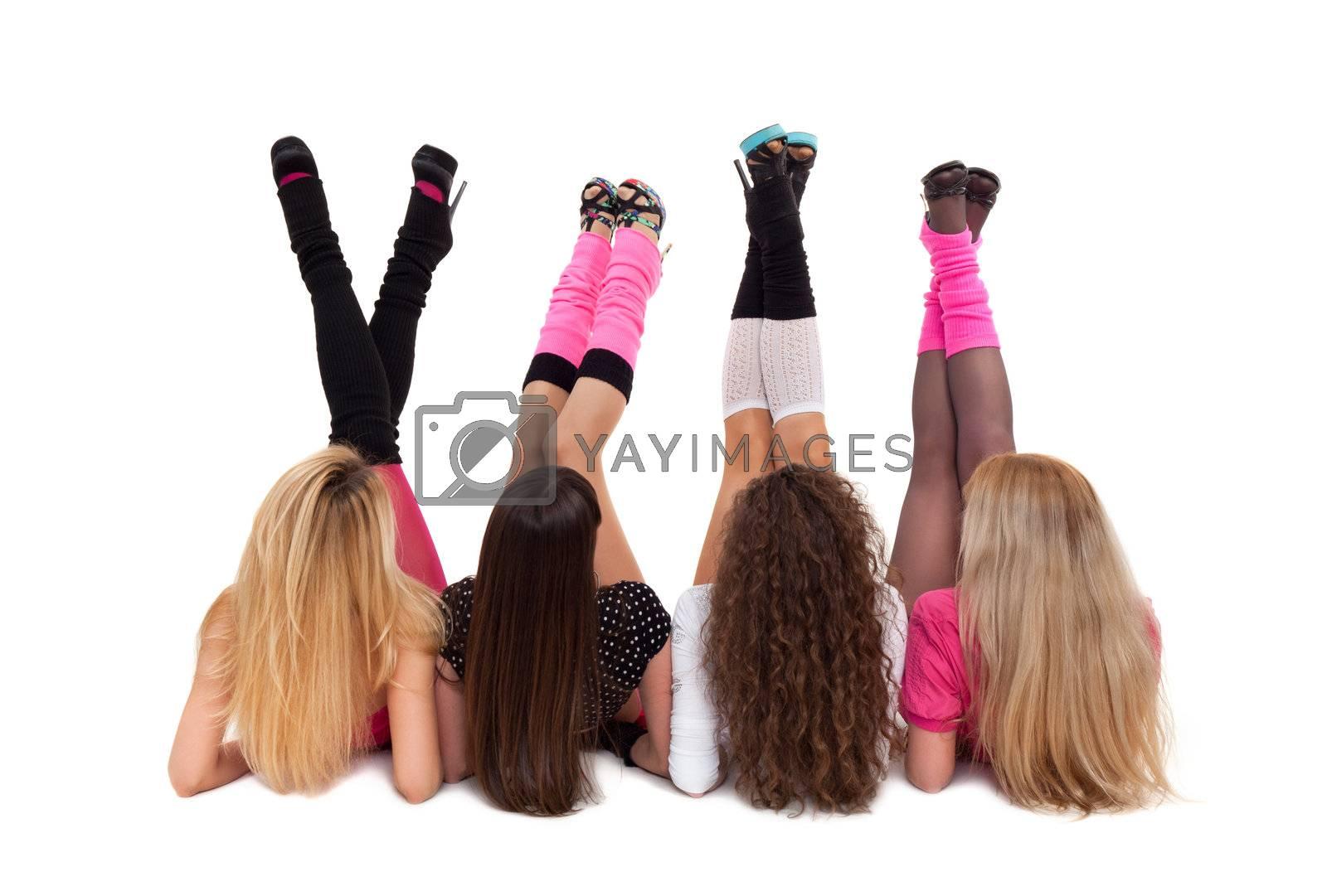Modern ballet of four dancers demonstrating their legs