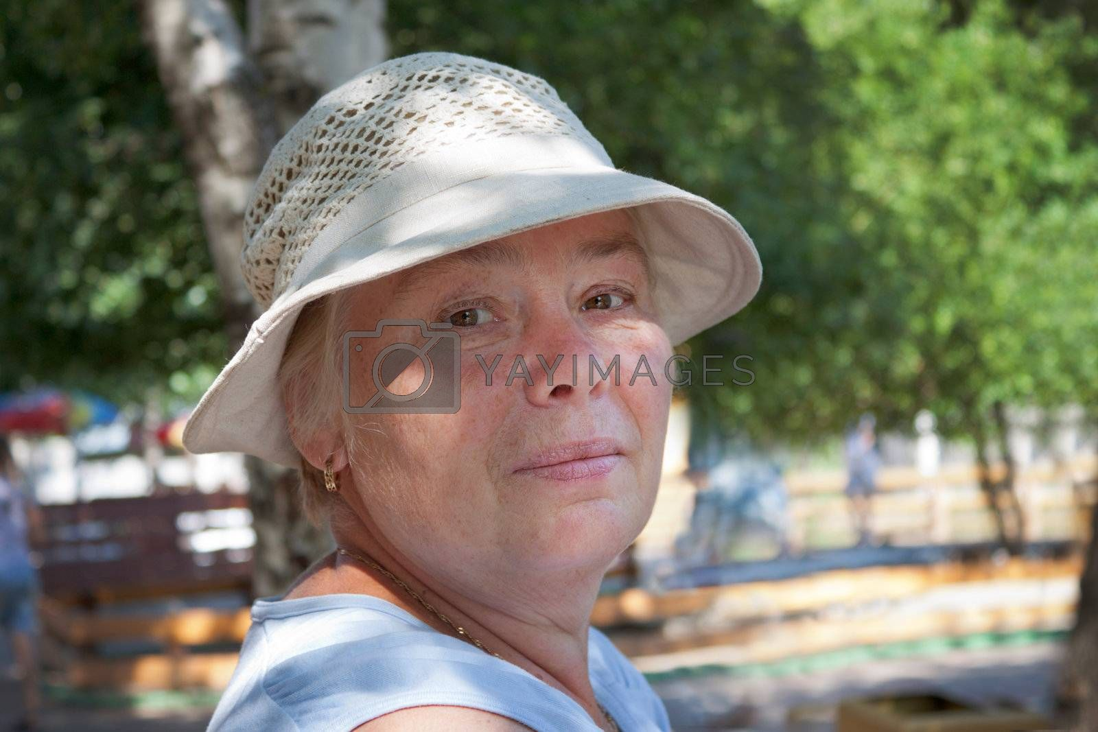 The pensioner at leisure in a summer park