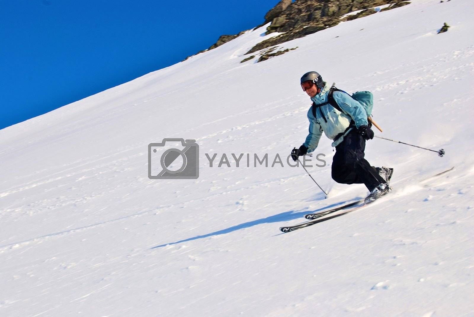 Royalty free image of skiing girl in white back by Bildehagen