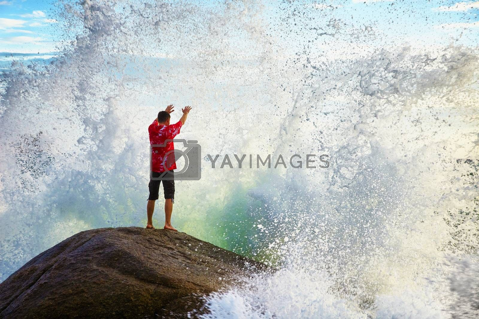 A young man prays sea elements