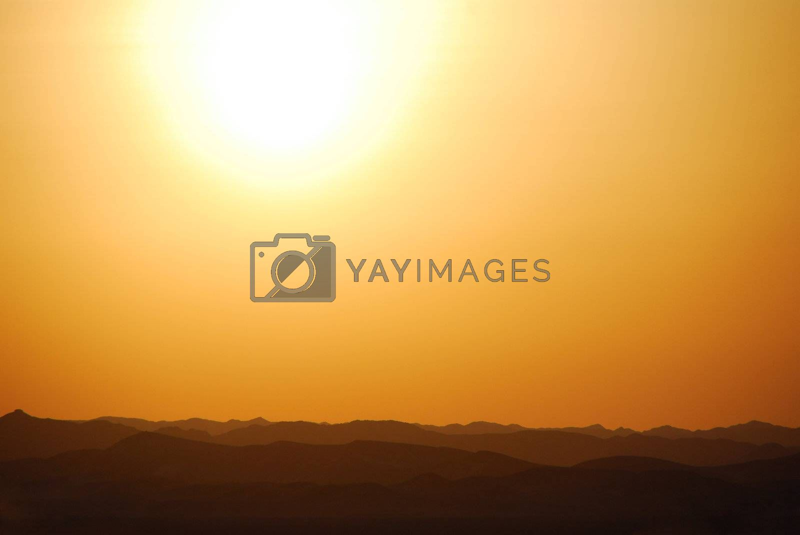 beautiful warm sunset with mountain in the desert egypt