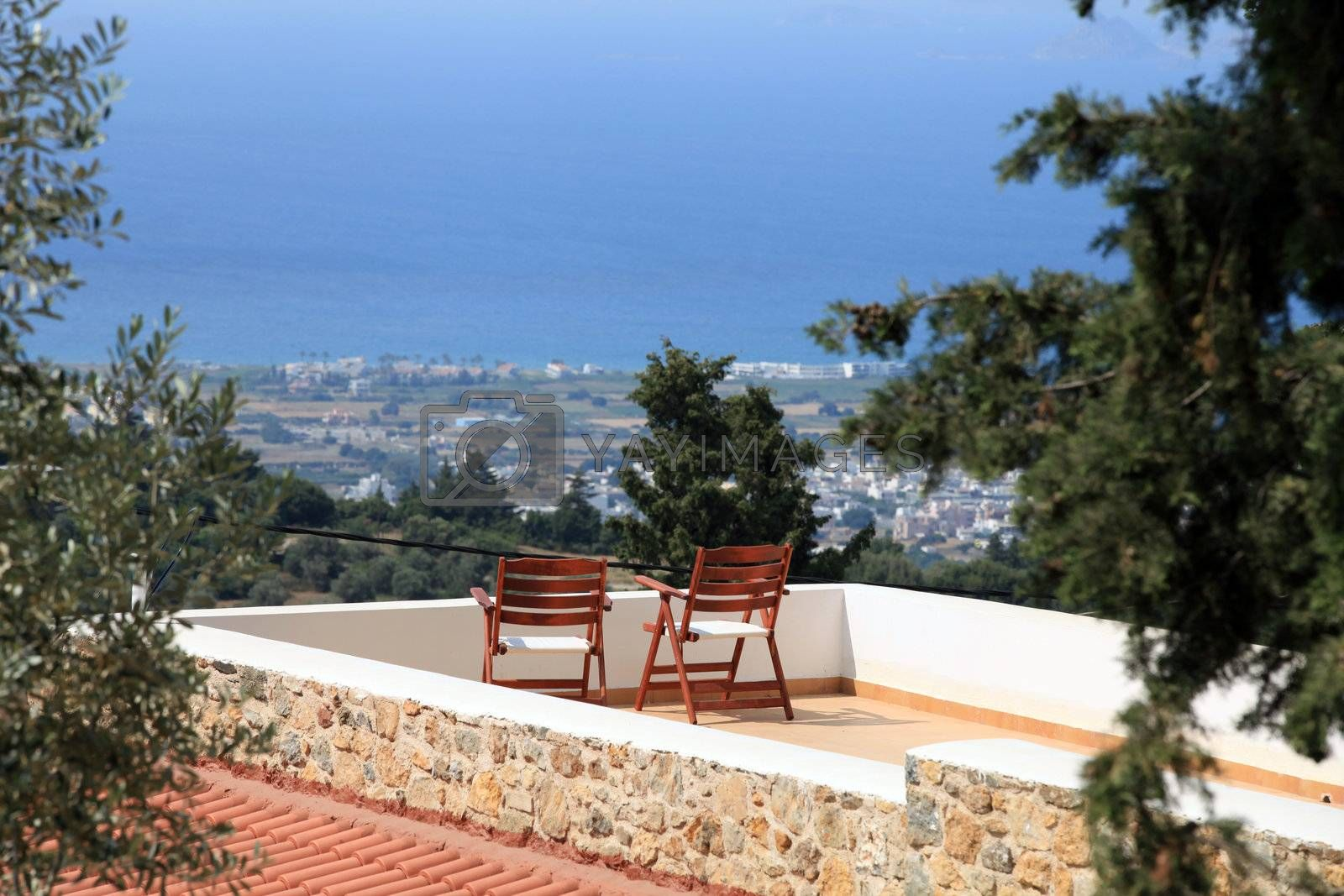 Two chairs on the terrace with a magnificent view. Zia, Kos Island , Greece