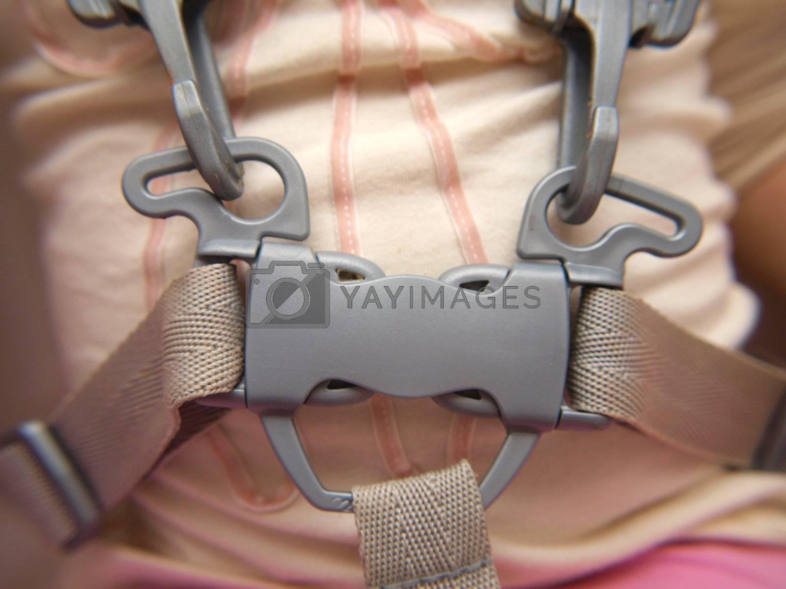 Closeup of a toddler wearing a belt, locked
