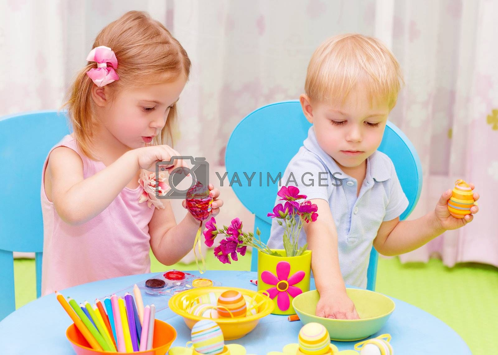 Royalty free image of Children paint Easter eggs by Anna_Omelchenko