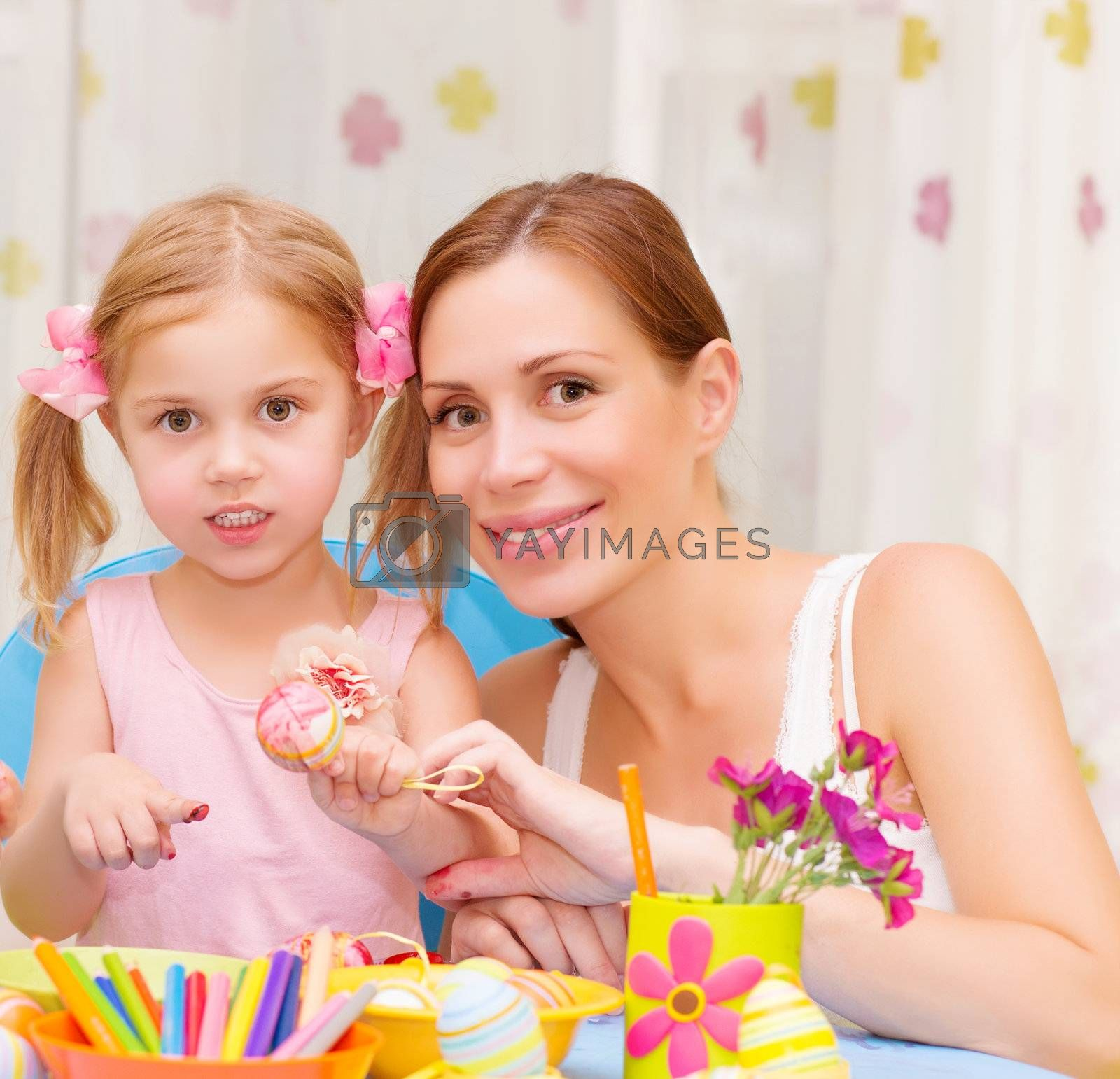 Mother with daughter painted Easter eggs by Anna_Omelchenko