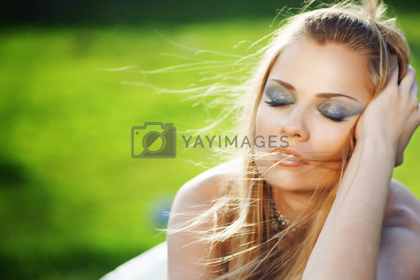 Portrait of a bride dreaming over fesh green grass