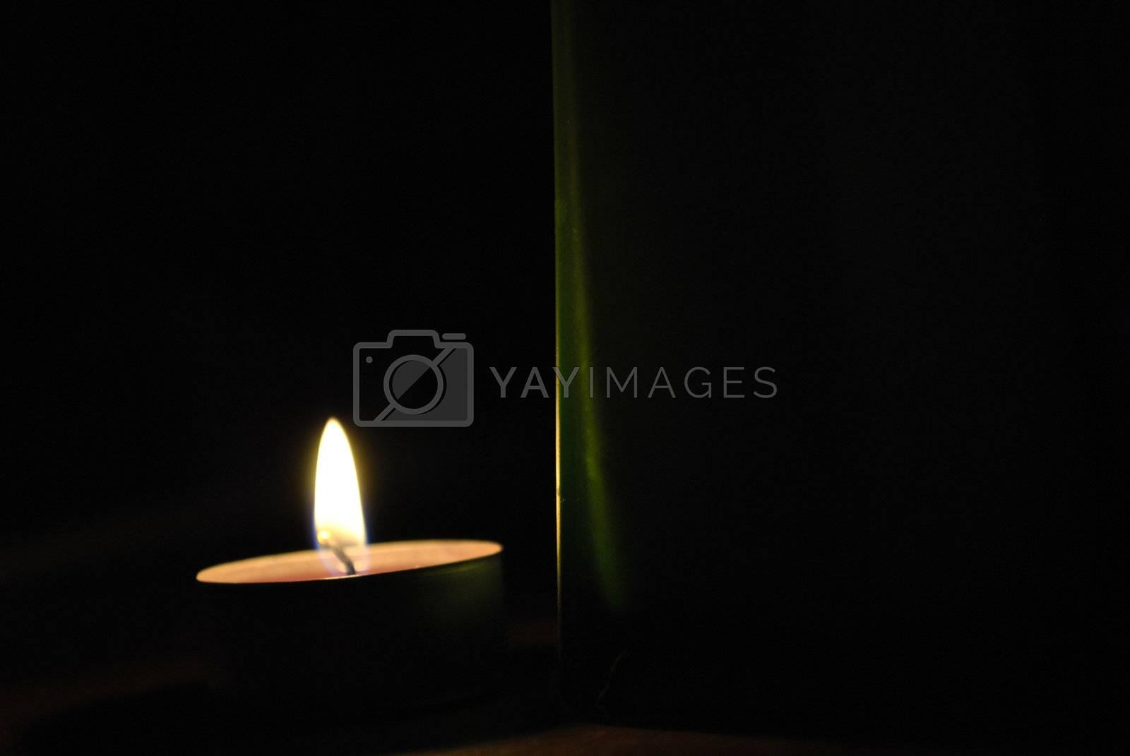 Burninging candle in the dark