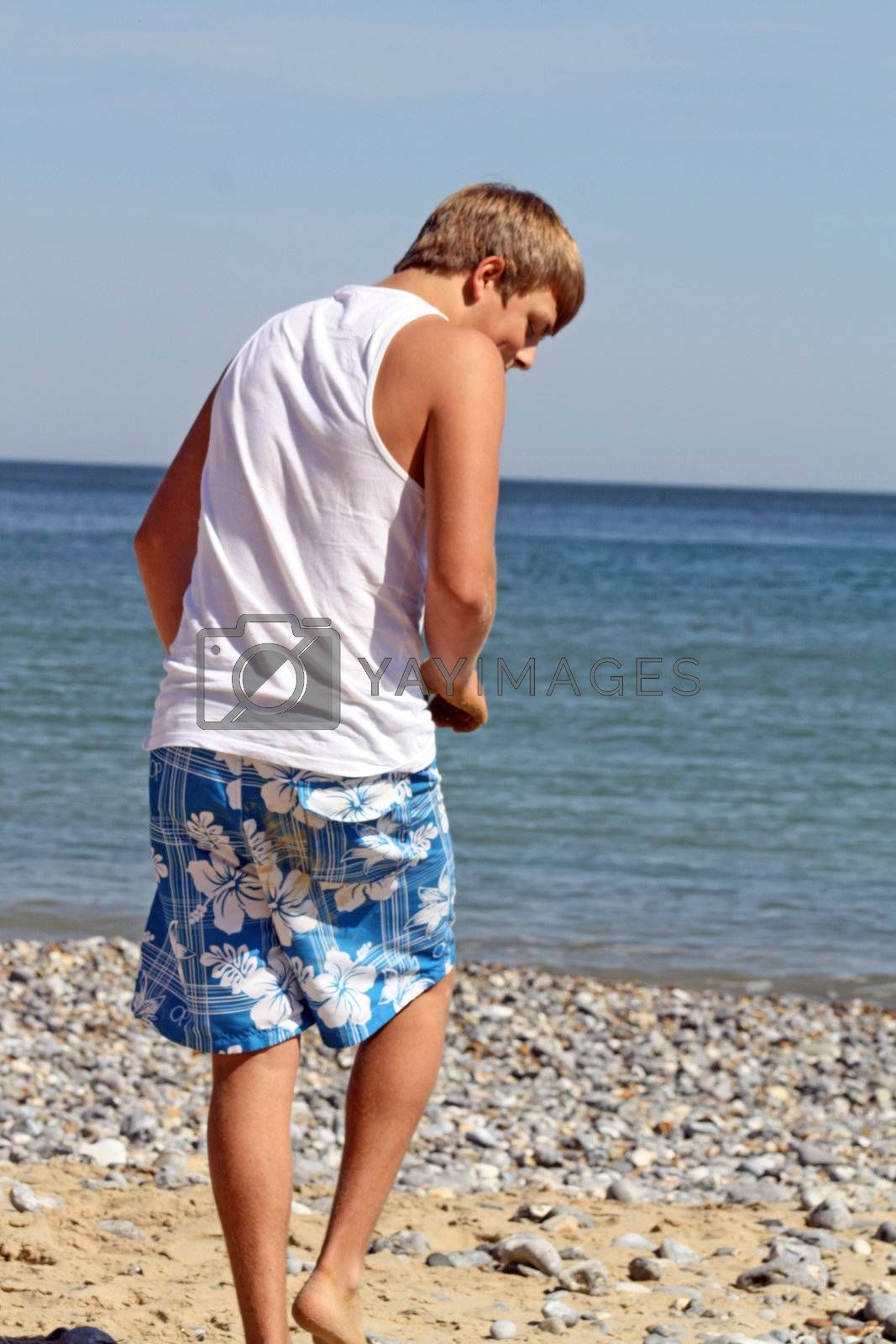 teenage boy looking out to sea