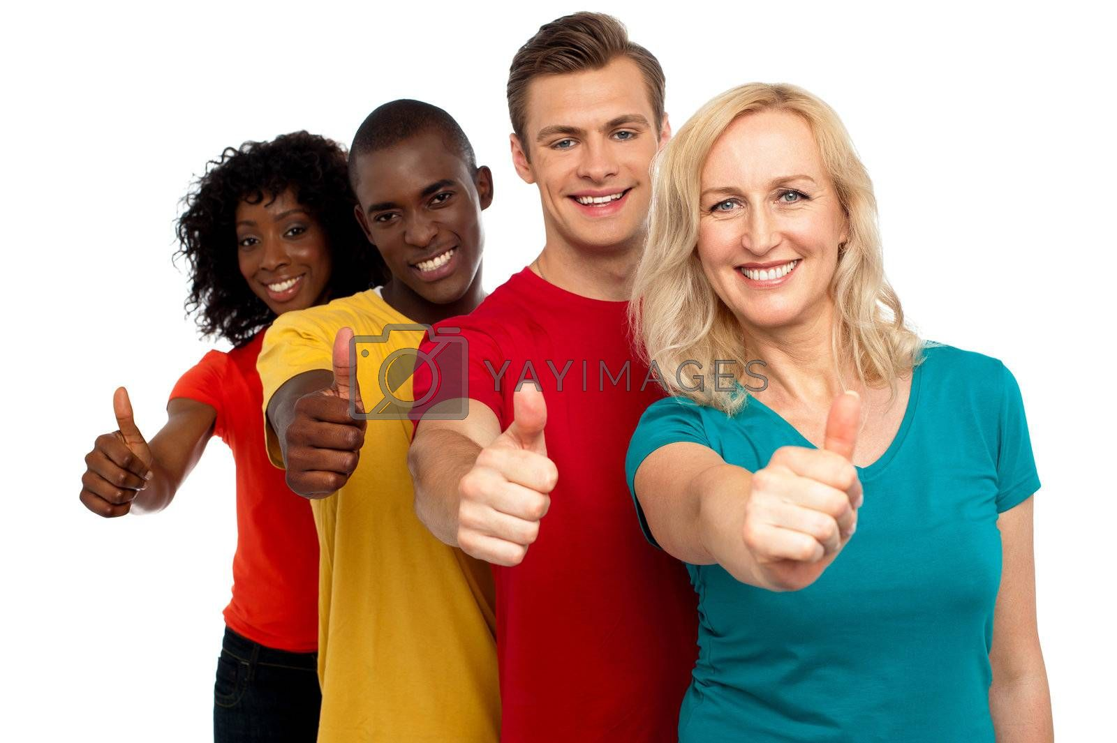 Smiling group of people with thumbs up gesture showing to camera