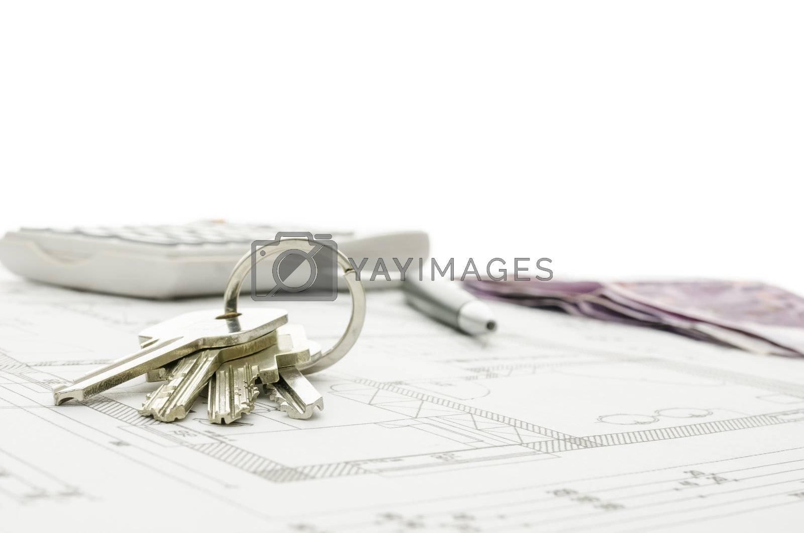 New house keys on blueprint. Copy space.