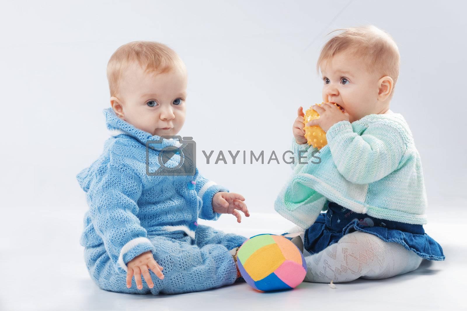 Studio portrait of two little children twins