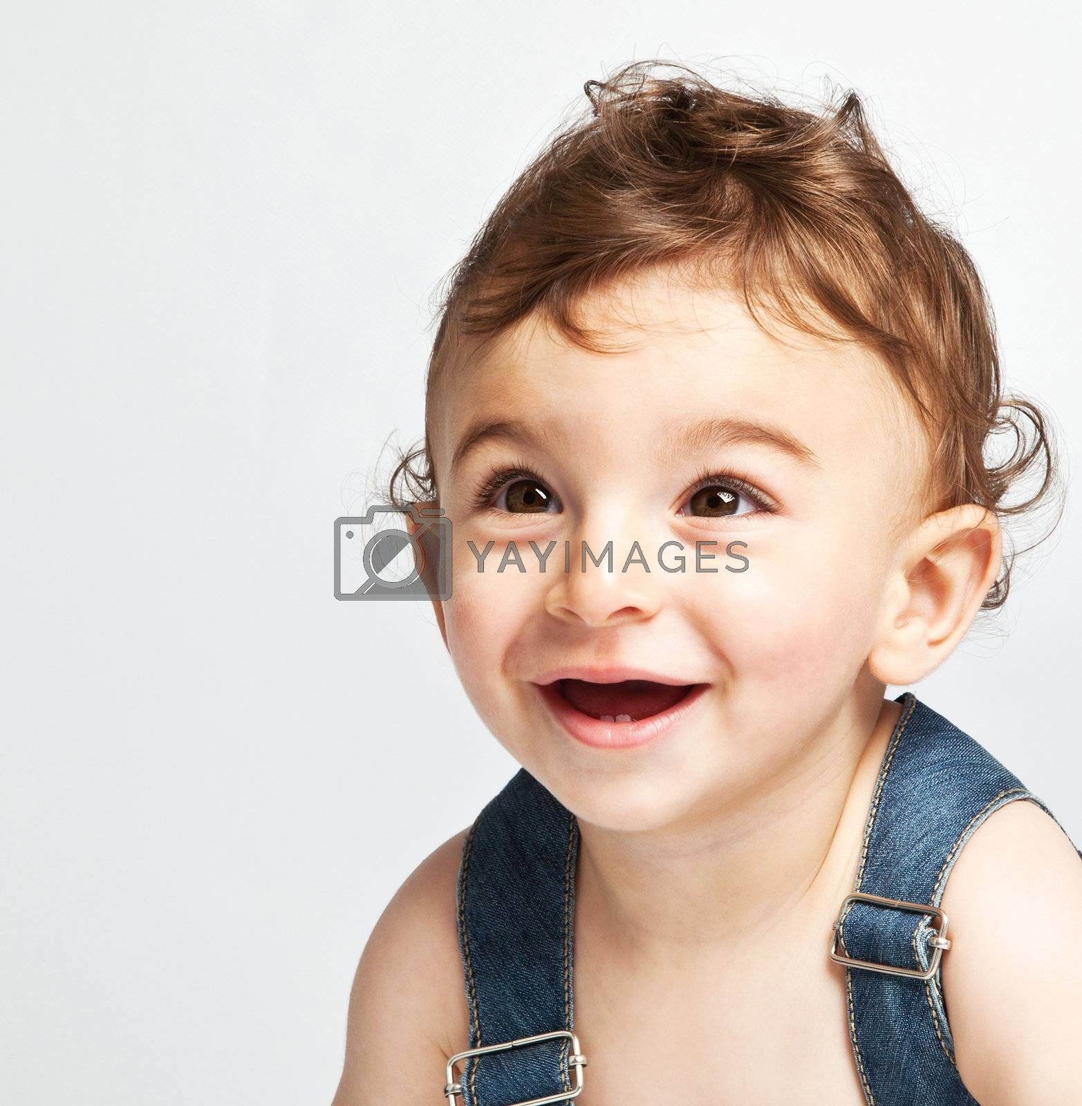 Cute baby boy isolated on white background, portrait of adorable sweet child, cheerful nice kid laughing indoor, pretty curious infant looking ahead, healthy lifestyle, happy childhood concept