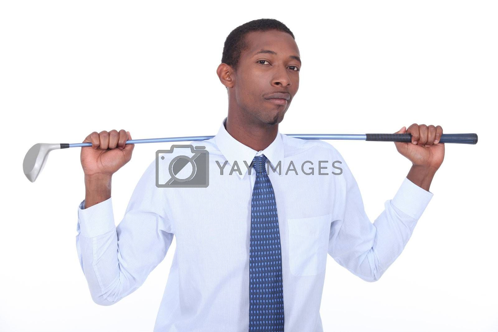 Businessman holding gold club