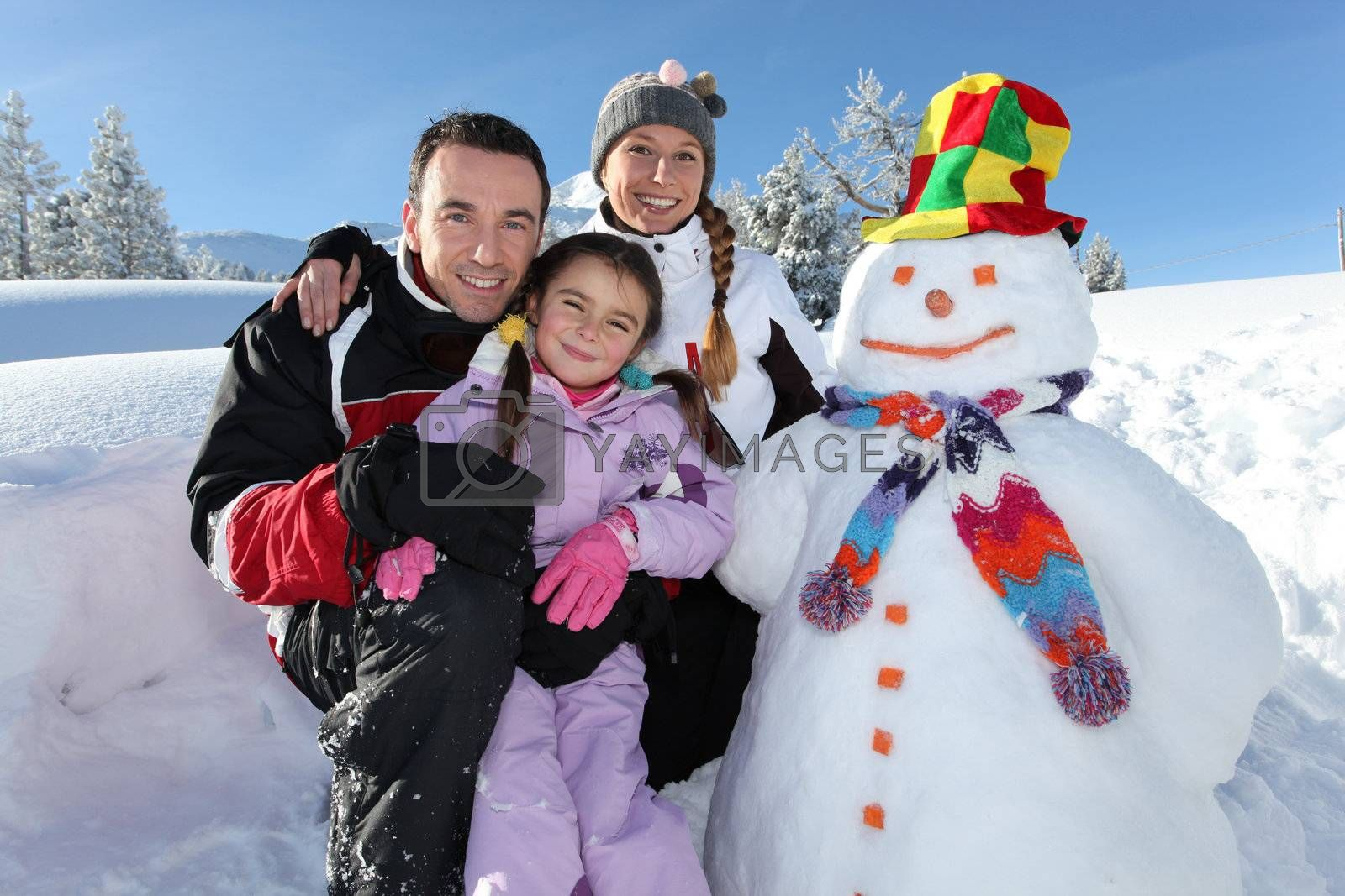 Family with a snowman by phovoir