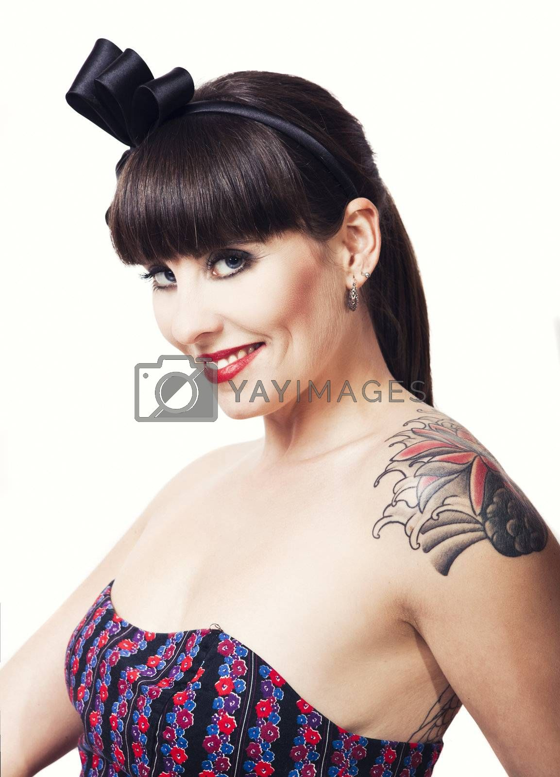 Beautiful woman with a vintage look posing, isolated over a white background