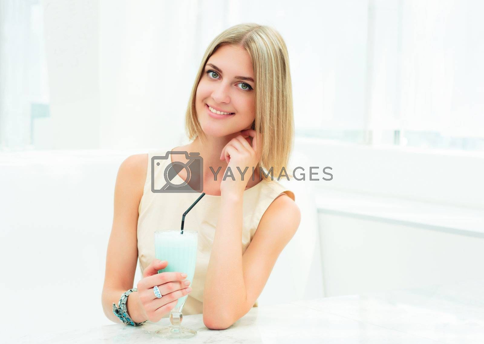 Portrait of a cute woman in urban cafe. bright colors, urban lifestyle
