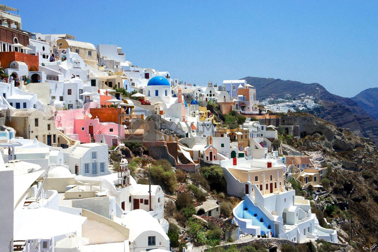 Amazing small white houses of Santorini, summer sunny day