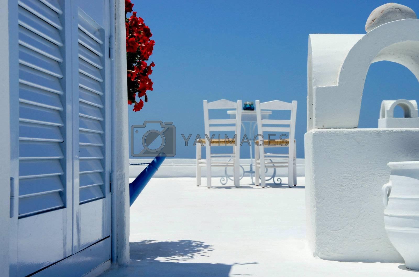 White, cosy, sunny amazing terrace in Santorini decorated in unique style